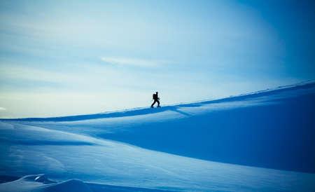 climbing a mountain. alpinists climbing a mountain photo