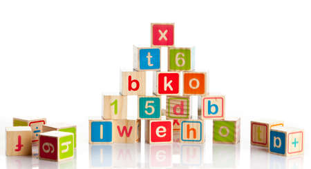 wooden toy cubes with letters. Wooden alphabet blocks. photo