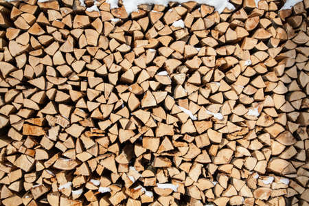pile of firewood. snowy firewoods in winter forest photo