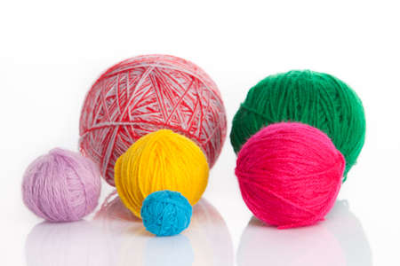 colorful different thread balls. wool knitting on white background photo