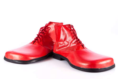 men s boot: Very big red clown shoes on white