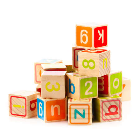 wooden toy cubes with letters. Wooden alphabet blocks. Stock Photo