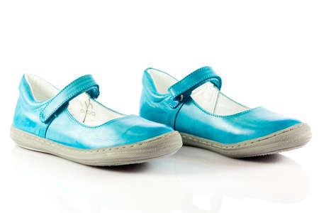 子供靴は、白で隔離。 写真素材