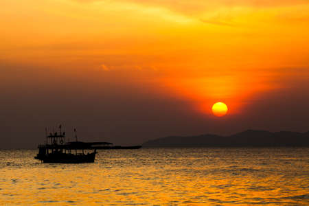 Fishing boat   in Thailand. Silhouette of Fishing Boat on Sunrise. photo