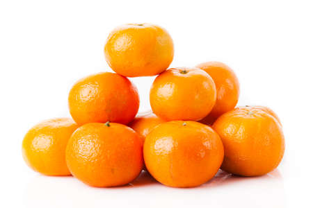 ripe juicy tangerine on a white background. Clementine Mandarin Oranges Stock Photo - 26780054