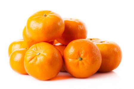 ripe juicy tangerine on a white . Clementine Mandarin Oranges Standard-Bild