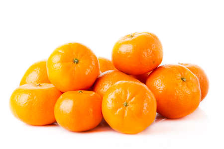 ripe juicy tangerine on a white background. Clementine Mandarin Oranges Stock Photo - 26860186
