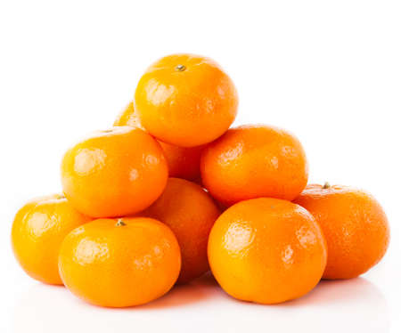 ripe juicy tangerine on a white background. Clementine Mandarin Oranges Stock Photo - 26861091