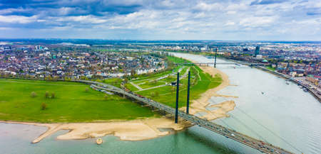 rhine westphalia: Wide angle picture of river Rhine, Duesseldorf. Seen from the television tower Rheinturm, Germany . Duesseldorf mediahafen (harbour) in Rheinland-Westphalia