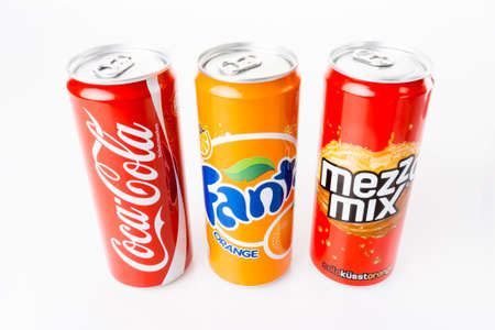 DUSSELDORF, GERMANY - March 28, 2014: Coca-Cola, Fanta and Mezzo Mix  cans on white background. The three drinks produced by the Coca-Cola Company are the worlds best sold refreshing drinks.