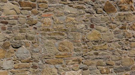 overbuilding: muro di pietra. texture muro di pietra. Sfondo muro di pietra Archivio Fotografico