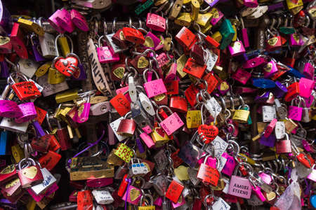 romeo and juliet: many colored locks of love in the gate of the House of Romeo and Juliet in verona in Italy