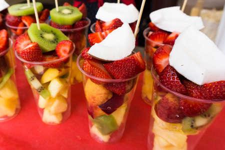 Fresh fruit salad on a market. Fruit Cocktail photo