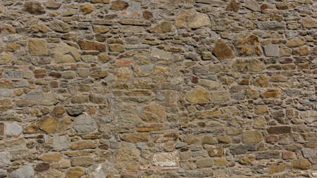 overbuilding: stone wall. stone wall texture.  Stone wall background Stock Photo