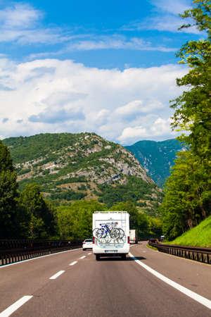white van on highway. Camper on the road. camping car Standard-Bild