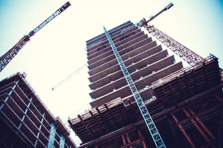 high rise buildings: Crane and building construction. big building construction Stock Photo