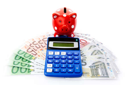 Piggy bank with euro money and calculator photo