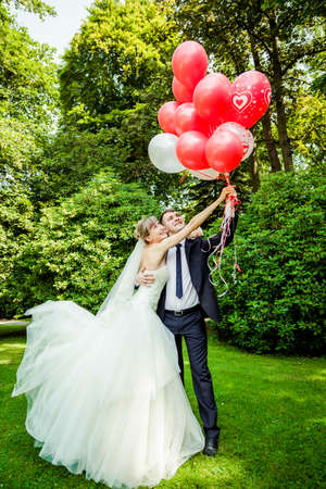 Couple of bride and groom with balloons photo