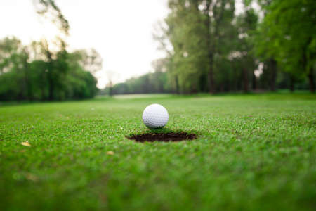 Golf ball on green meadow photo