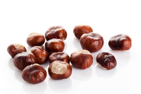 Chestnut on white background. ripe chestnuts