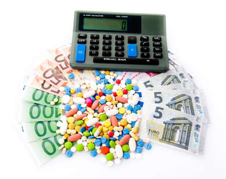 high cost of healthcare: pills and euro banknotes. medical concept