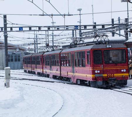 loc: Train station in the Swiss Alps. JUNGFRAU, SWITZERLAND. Mountain Train