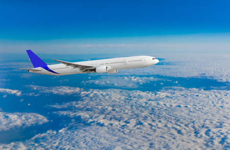 turbulence: Passenger airplane flying above dramatic clouds Stock Photo