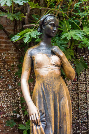 Statue of juliet in verona, italy. The Juliets statue at Juliets house is one of the most popular and symbolic tourist attractions in Verona, Italy. photo