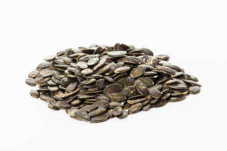 pumpkin seeds isolated on white . Fresh roasted Pumpkin Seeds photo