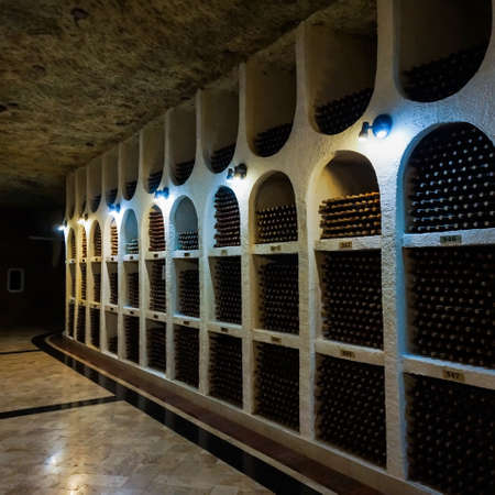 intoxicant: wine bottles in wine cellar