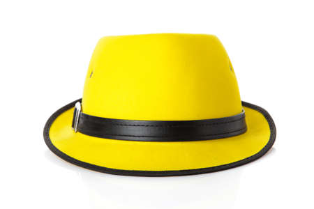 isolated on yellow: yellow straw hat isolated on white Stock Photo