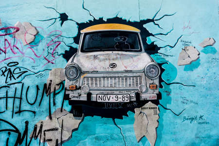 BERLIN, GERMANY - MARCH 20: Berlin Wall graffiti seen on March 22, 2015, Berlin, East Side Gallery. It's a 1.3 km long part of original Berlin Wall which collapsed in 1989.