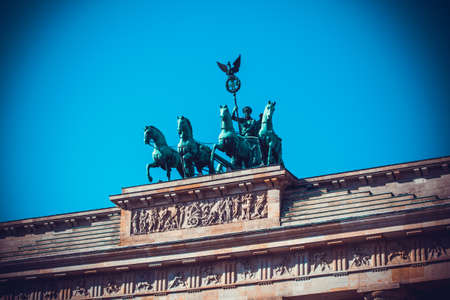triumphant: Brandenburg Tor detail. Berlin, Germany. Victory and Fame often are depicted as the triumphant woman driving the chariot. Editorial