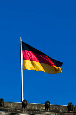 german flag: Silky flag of Germany flying in the wind.  German flag on the top of Reichstag building, Berlin, Germany Stock Photo