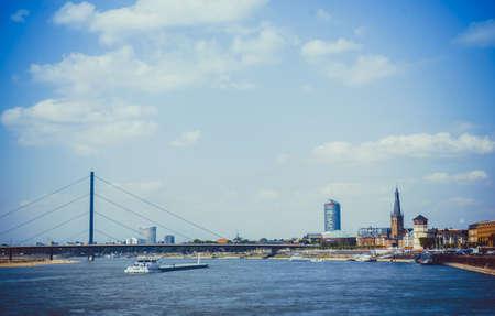 rhein: Duesseldorf skyline with Rheinturm and river