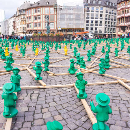 roemer: FRANKFURT, GERMANY - SEPTEMBER 19, 2015: figures from Ottmar Hoerl to celebrate the 25th anniversary of Germanys reunion in Frankfurt, Germany on public places.