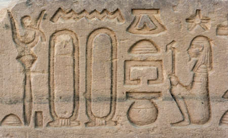 pharoah: old egypt hieroglyphs carved on the stone. Detail from temple wall in Egypt.