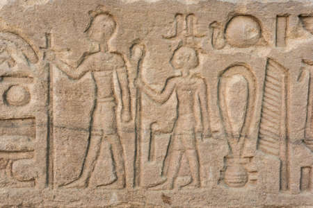 past civilizations: old egypt hieroglyphs carved on the stone. Detail from temple wall in Egypt.