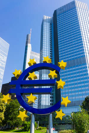 ecb: FRANKFURT AM MAIN, GERMANY, SEPTEMBER 11, 2015: Euro currency sign in downtown of Frankfurt near old headquarters of the European Central Bank or ECB