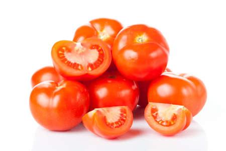 tomato slice: Fresh tomatoes isolated on white.