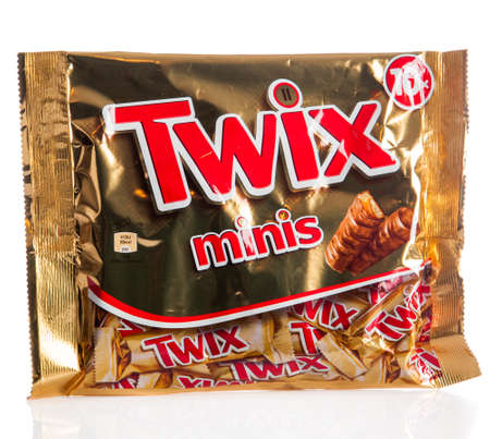 mars incorporated: DUSSELDORF, GERMANY - NOVEMBER 24, 2015.  Twix cookie bars isolated on white background. Twix bars are produced by Mars Incorporated and sold worldwide. Editorial