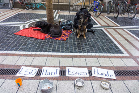 marginalized: homeless with two Dogs.  Germany