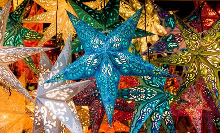 christmas market: Colorful Christmas stars.  Christmas Market. Christmas decorations Stock Photo