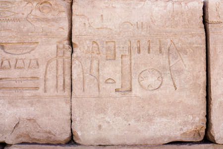 hieroglyphic: Egyptian hieroglyphs. Hieroglyphic carvings on a wall Stock Photo