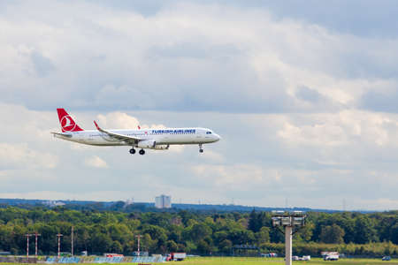 scheduled: FRANKFURT, GERMANY - SEPTEMBER 25, 2015: Turkish Airlines Airbus A321 landing at  Frankfurt Airport. The company operates scheduled services to 146 international and 41 domestic cities Editorial
