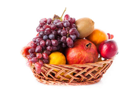 fruits in a basket: Fruits  in the basket. assorted fruits in wicker basket Stock Photo