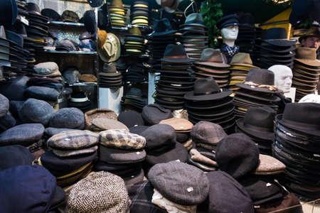 berets: cap on market.   hats, berets and other headdress