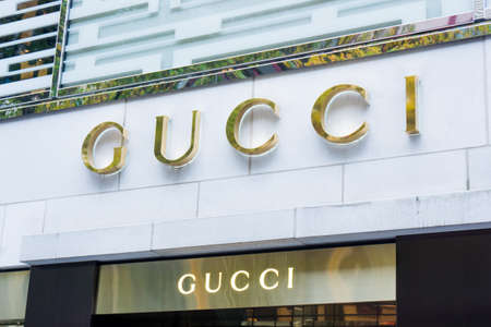 gucci store: FRANKFURT, GERMANY - OKTOBER 24, 2015:  Gucci signage at store entrance. Gucci is an Italian fashion label owned by French company PPR. Gucci was founded by Guccio Gucci in Florence in 1921