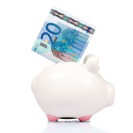 euro bill: blue Piggy bank with 20 Euro bill. 20 Euro note Stock Photo