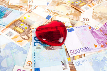 mercantile: Red Heart and Money for background.  Euro banknotes and a red heart. Stock Photo